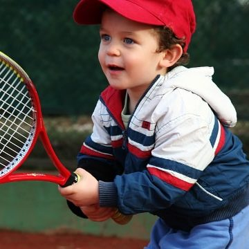 ANZ Hot Shots Mini - Happy little boy playing tennis